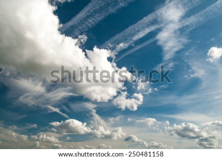Blue sky with various shapped cloud formations - stock photo