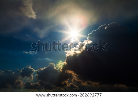 Blue sky with white and grey clouds