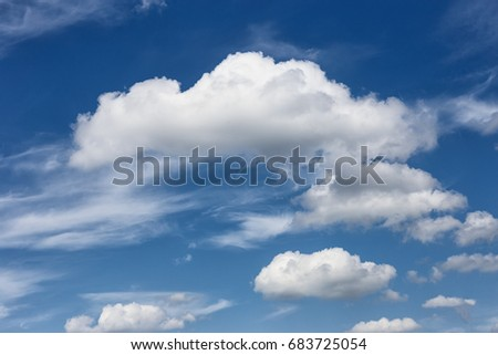 blue sky with white cloud in the foreground as the background/a beautiful blue sky day with white clouds