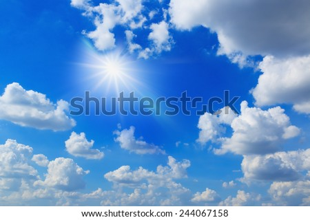 Blue sky with white clouds  and sun rays - stock photo