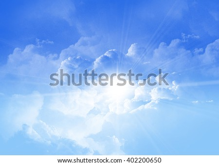 blue sky with white clouds and sun rays