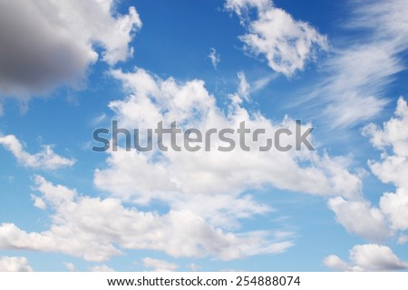 Blue sky with white clouds, horizontal background - stock photo