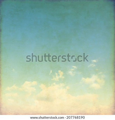 Blue sky with white clouds in grunge style.