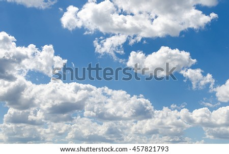 Blue sky with white clouds. Photo of the sky in sunny day.