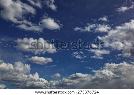 Blue sky with white cumulus clouds. - stock photo