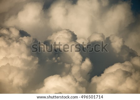 Blue sky with white cumulus clouds. Toned.