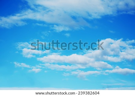 blue sky with white, fluffy clouds.