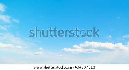 blue sky with white, soft clouds - stock photo