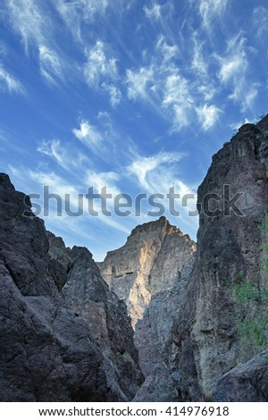 blue sky with wispy clouds over White Rock Canyon in Arizona - stock photo