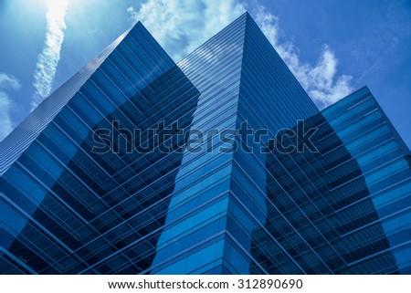 Blue Skyscraper Jets into the sky - stock photo
