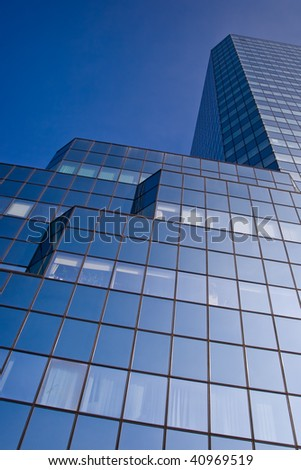 Blue skyscraper on a clear blue sky background