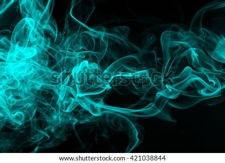 Blue smoke on black background, movement of blue smoke - stock photo