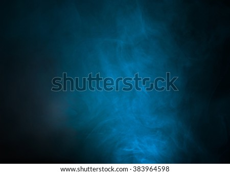 Blue smoke over black studio background - stock photo
