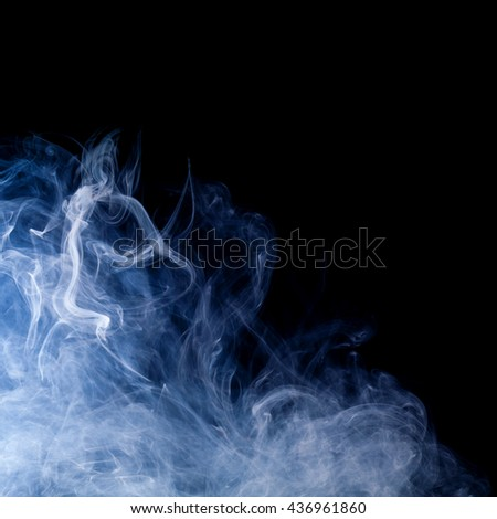 blue smoke swirls over black background - stock photo