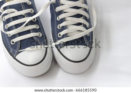Blue sneakers are on a white background.
