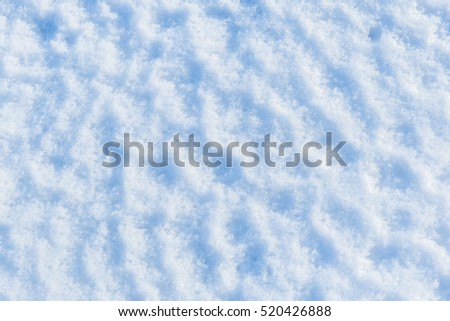 Blue snow texture or winter white background with grain rough pattern