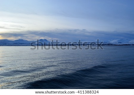 blue snowy mountain and fjord landscape
