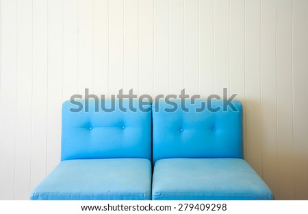 Blue Sofa and White wooden wall