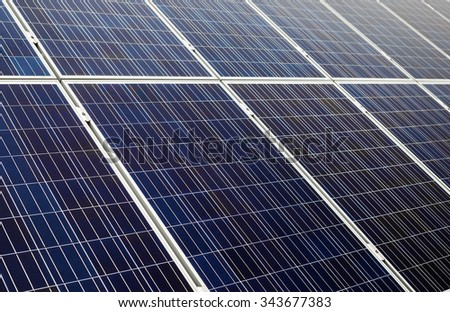 Blue solar cells. Photovoltaic panels. Shallow depth of field. Selective focus.