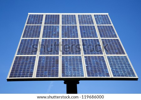 blue solar panel and very blue sky - stock photo