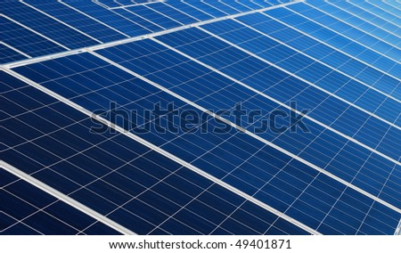 Blue solar panels arrangement - stock photo