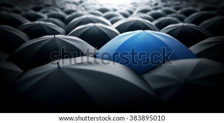 Blue special umbrella, special one concept - stock photo