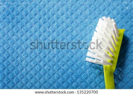 Blue sponge background and cleaning brush - stock photo