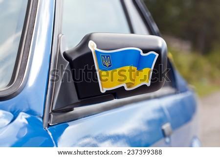 Blue sport car mirror close-up - stock photo