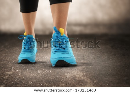 blue sport shoes and gray dark interior  - stock photo