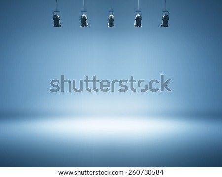 blue spotlight background with studio lamps - stock photo