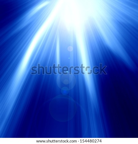 blue spotlight on stage with some glitter and sparkle on it - stock photo