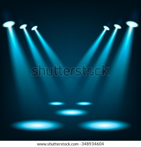Blue spotlights shining in dark place background