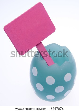 Blue spotted Easter Egg with Blank Pink Sign Isolated on White with a Clipping Path.