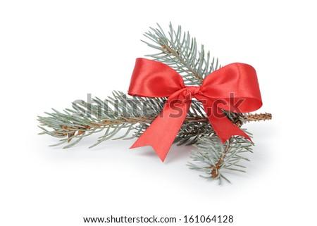 blue spruce twig with ribbon bow, isolated on white background - stock photo