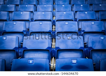 Blue stadium seats in a frontal view. - stock photo