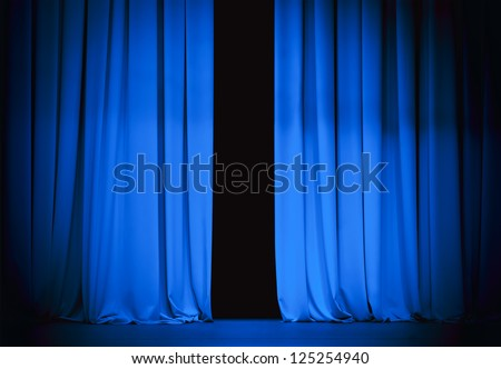 blue stage curtain slightly open - stock photo