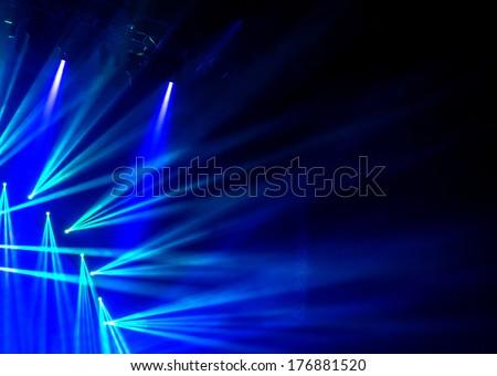 Blue stage light, abstract background, illuminated dance club, night performance, laser illumination, luxury rock concert projector - stock photo