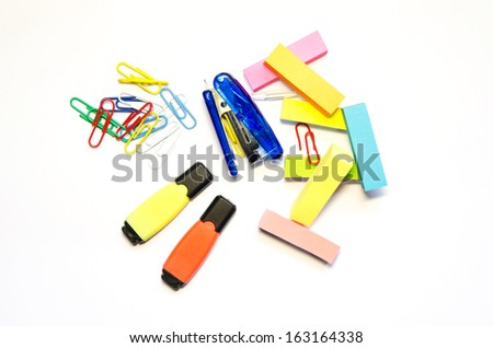 Blue stapler, Pile of colorful paper clips ,Two markers of different colors and four color block of post-it notes with clipping path on white background - stock photo