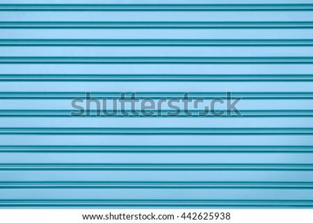 Blue steel door with horizontal lines background. - stock photo