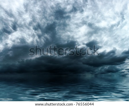 Blue storm clouds on a sky background over water surface - stock photo