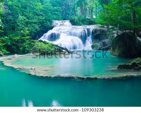Blue stream waterfall in Kanjanaburi Thailand - stock photo