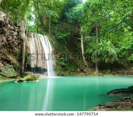 Blue stream waterfall in Kanjanaburi Thailand (Erawan waterfall Nation Park) - stock photo