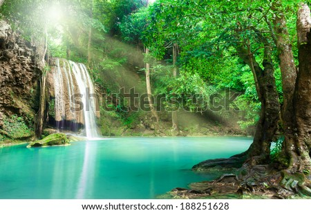 Blue stream waterfall in Kanjanaburi Thailand (Erawan waterfall Nation Park) - stock photo