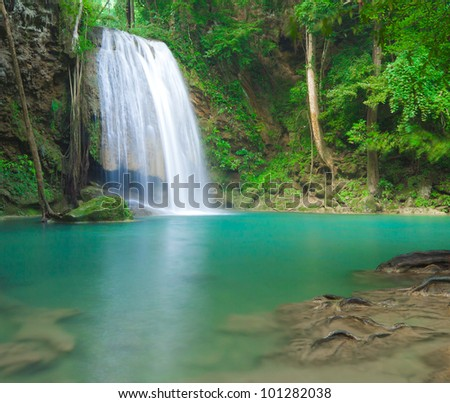 Blue stream waterfall in Kanjanaburi Thailand (Erawan waterfall national park) - stock photo