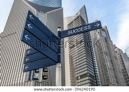 Blue street guidance board with success word in Shanghai Financial District.