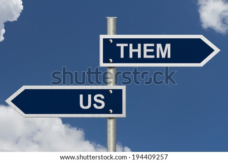 Blue street signs with blue sky with words Us and Them, Us versus Them
