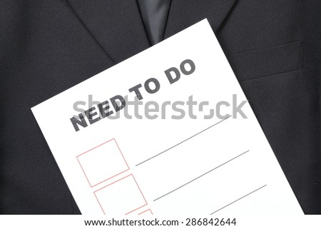 Blue suit and the printed paper with text appear the word and blank table represent the business concept related idea.