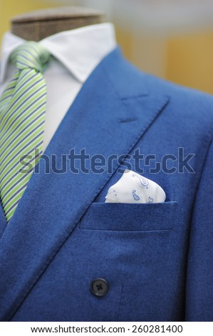 Blue suit with tie, tie clip and handkerchief. Focused on handkerchief.  - stock photo