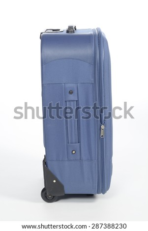 Blue suitcase on white background