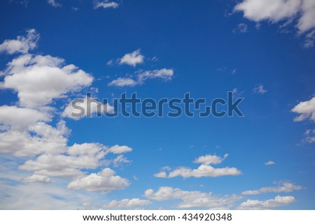 Blue summer sky in Mediterranean sea with white clouds